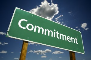 A sign that reads commitment.