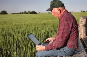 Farmer using laptop computer