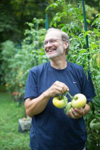 Craig LeHoullier holding tomatoes
