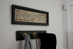 Framed crosstitch that says kindness matters