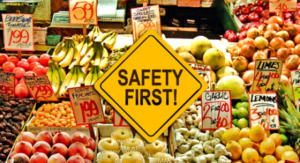 Produce area in market with a safety first sign in front