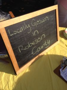 "Sign saying ""Locally Grown in Robeson County"""