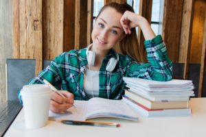 Female student with text books and notebooks