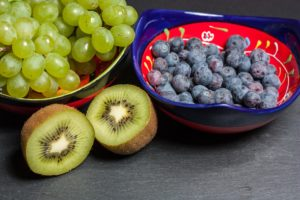 bowl filled with green grapes and blueberries