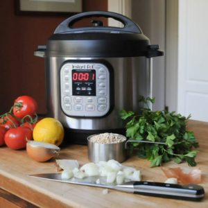 Multi Cooker with vegetables and kitchen utensils